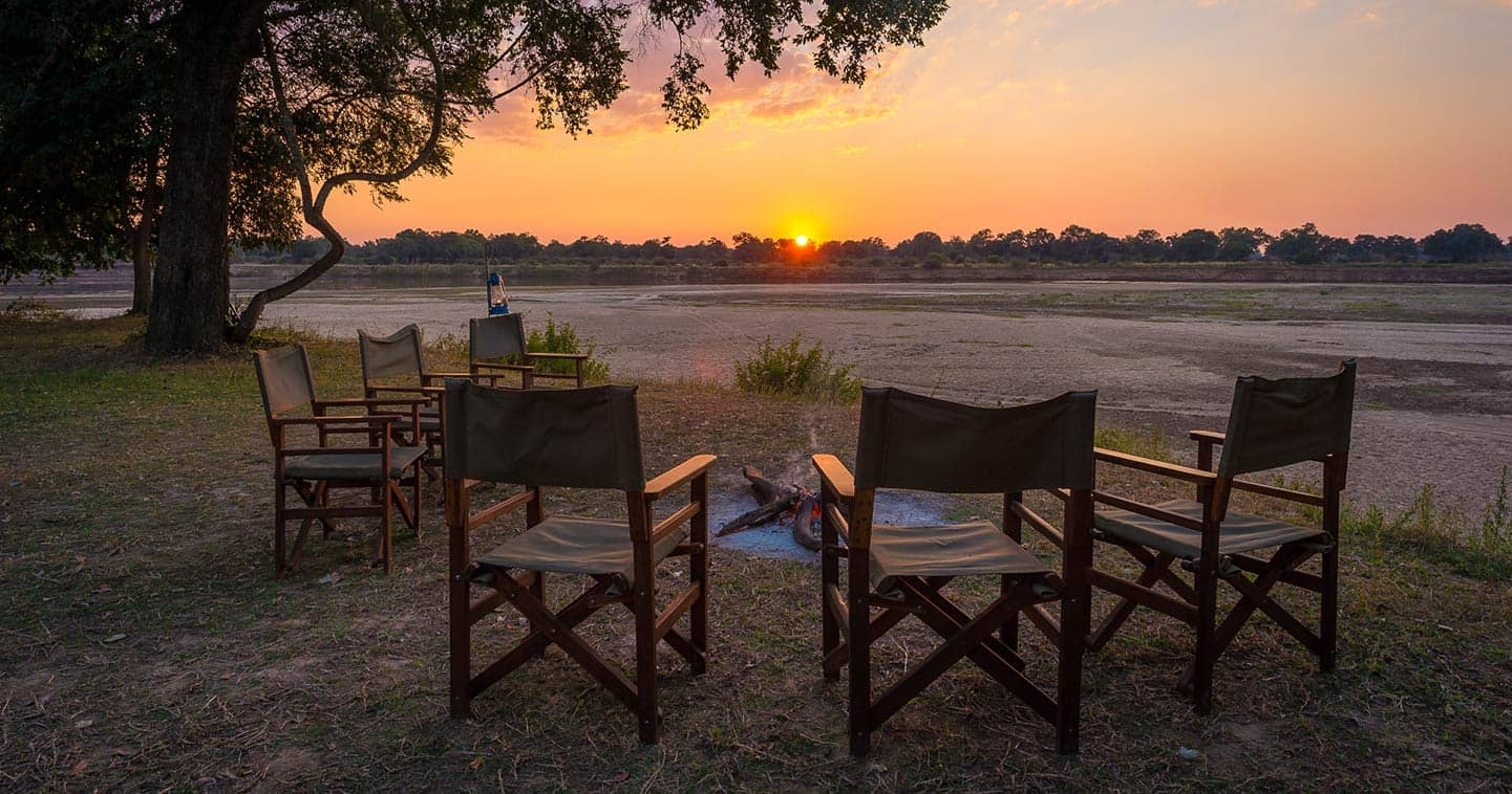 Enjoy the Sundown at the Boma When you Stay at Luangwa River Camp in the South Luangwa National Park