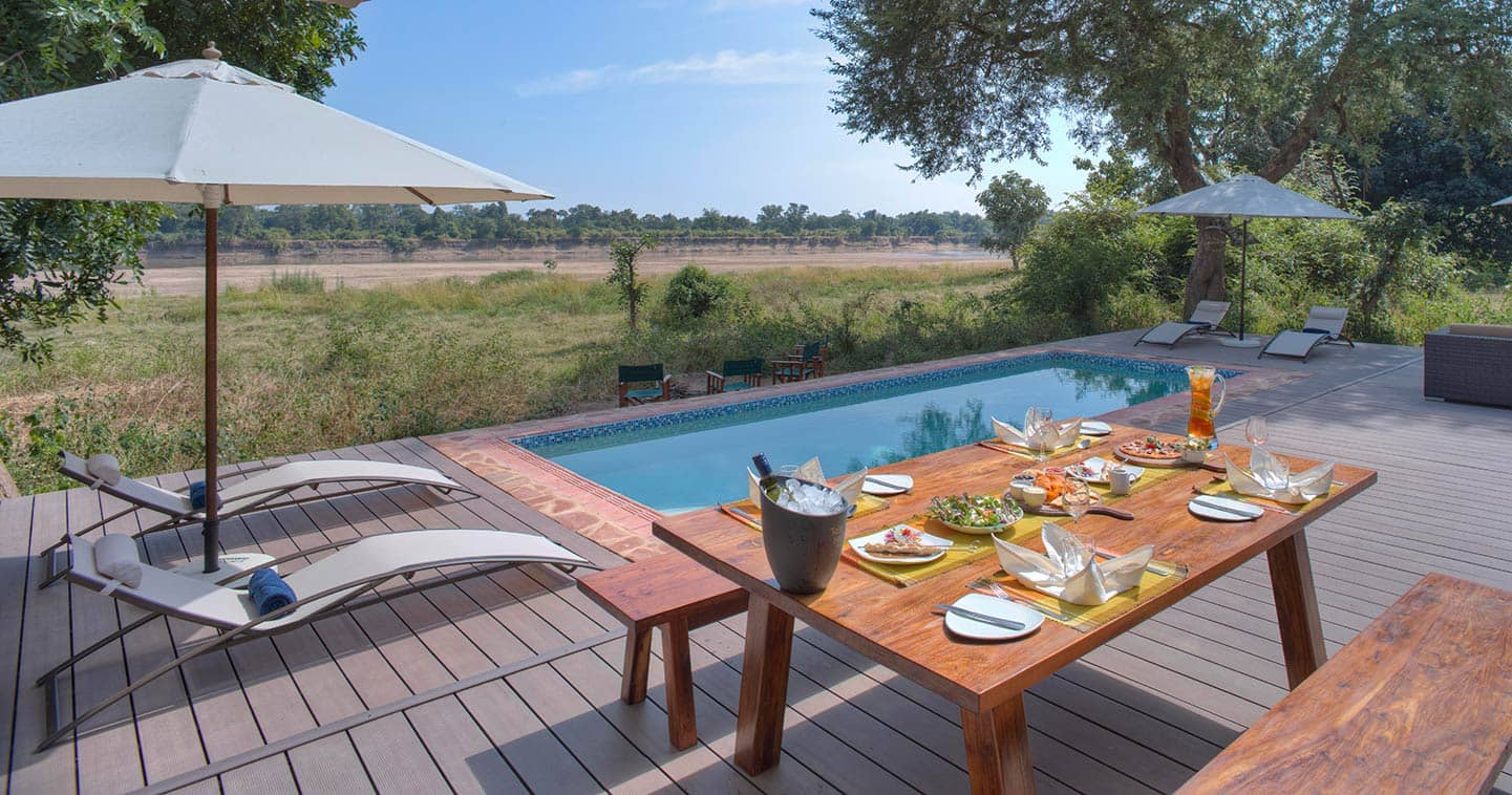Enjoy Your Lunch Next to the Pool at Flatdogs Camp in the South Luangwa National Park in Zambia